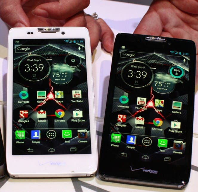 Product specialists display new Motorola droid phones Droid Razor M, Droid Razor HD and the Droid Razor Maxx HD during a launch event in New York