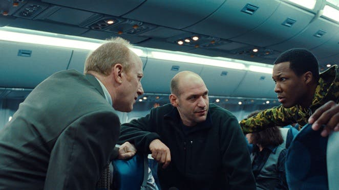 (L to R) Charles (FRANK DEAL), Austin (COREY STOLL) and Travis (COREY HAWKINS) discuss a plan to stop the threat in ?Non-Stop?, a suspense thriller played out at 40,000 feet in the air.  During a transatlantic flight from New York City to London, U.S. Air Marshal Bill Marks (Liam Neeson) receives a series of cryptic text messages demanding that he instruct the airline to transfer $150 million into an off-shore account.  Until he secures the money, a passenger on his flight will be killed every 20 minutes.