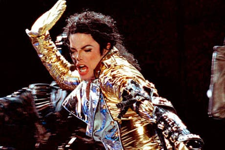 Michael Jackson performs during a concert in Budapest, Hungary in 1996.