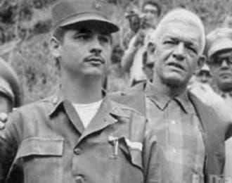 El coronel Rafael Tomás Fernández Domínguez y el expresidente Juan Bosch. Foto: Archivo.
