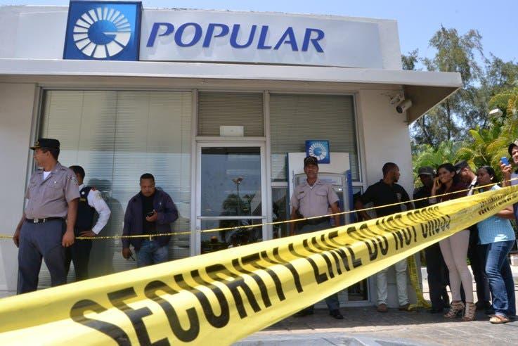 Image result for sucursal del banco popular asaltada en el ensanche isabelita
