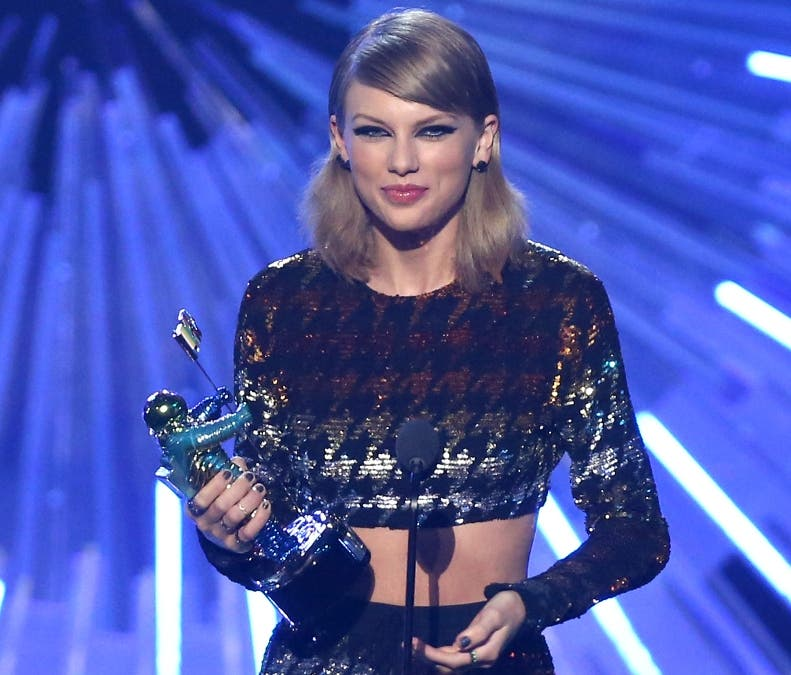 "Taylor Swift accepts the award for female video of the year for ""Blank Space"" at the MTV Video Music Awards at the Microsoft Theater on Sunday, Aug. 30, 2015, in Los Angeles. (Photo by Matt Sayles/Invision/AP)"
