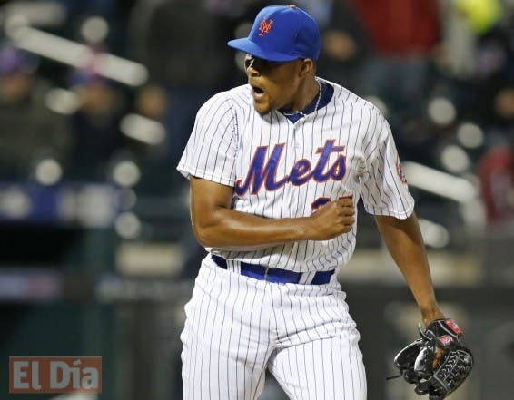 New York Mets relief pitcher Jeurys Familia (27) reacts after the Mets earned their tenth consecutive victory in a baseball game against the Atlanta Braves in New York, Wednesday, April 22, 2015. (AP Photo/Kathy Willens)