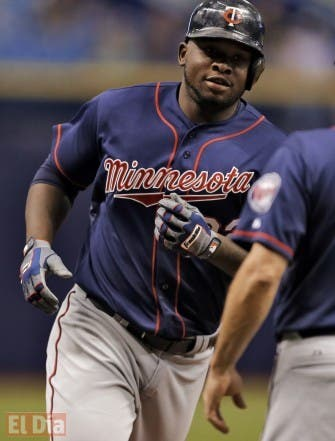 Minnesota Twins' Miguel Sano prepares to shake hands with third base coach Gene Glynn (13) after hitting a three-run home run off Tampa Bay Rays starting pitcher Nathan Karns during the first inning of a baseball game Tuesday, Aug. 25, 2015, in St. Petersburg, Fla. Twins' Byron Buxton and Joe Mauer also scored. (AP Photo/Chris O'Meara)