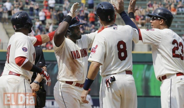 Cleveland Indians' Abraham Almonte, second from left, is congratulated after hitting a grand slam off Los Angeles Angels starting pitcher Jered Weaver in the fifth inning of a baseball game, Sunday, Aug. 30, 2015, in Cleveland. Indians' Michael Brantley, right, Carlos Santana, left, and Lonnie Chisenhall also scored on the play. (AP Photo/Tony Dejak)