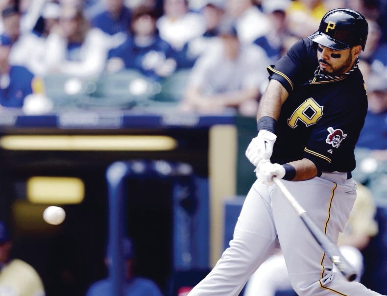 Pittsburgh Pirates' Pedro Alvarez hits a two-RBI double against the Milwaukee Brewers during the third inning of a baseball game on Sunday, May 26, 2013, in Milwaukee. (AP Photo/Jeffrey Phelps)