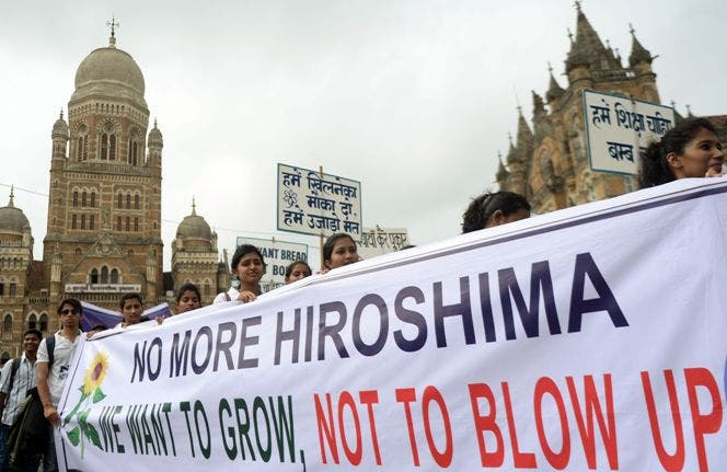 Indian students carry a banner with slogan for peace as they take part in a rally to mark Hiroshima Day in Mumbai on August 6, 2015. The world has marked the 70th anniversary of world's first nuclear attack on Hiroshima - the moment in 1945 when a single US bomb instantly killed more than 140,000 people and fatally injured tens of thousands of others with radiation or horrific burns. AFP PHOTO/ PUNIT PARANJPE