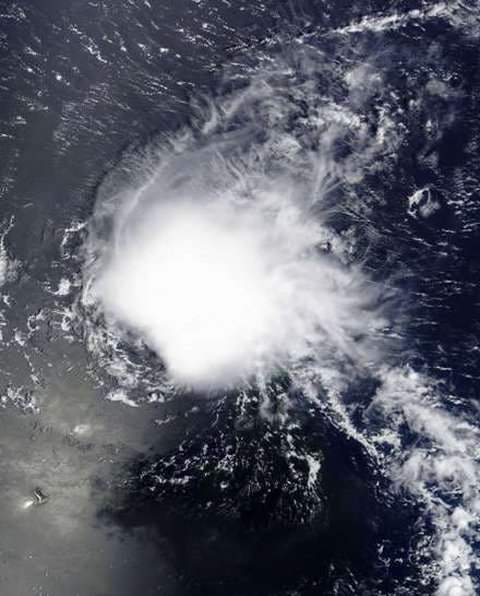 """This August 23, 2015 NASA satellite image shows Tropical Storm Danny in the Atlantic Ocean.  US forecasters downgraded Danny, formerly the first hurricane of the Atlantic season, to a tropical depression August 24, 2015 as it reached the Caribbean. The weather system, with maximum sustained winds near 35 miles per hour (55 kilometers per hour), was located about 20 miles (30 kilometers) south of Guadeloupe, the National Hurricane Center said in its latest update. It was expected to weaken further over the next 48 hours and """"degenerate into a remnant low"""" later in the day, according to the Miami-based forecasters. AFP PHOTO/ NASA          = RESTRICTED TO EDITORIAL USE - MANDATORY CREDIT """"AFP PHOTO/NASA """" - NO MARKETING NO ADVERTISING CAMPAIGNS - DISTRIBUTED AS A SERVICE TO CLIENTS ="""