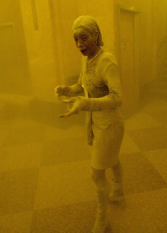 (FILES) This September 11, 2001 file photo shows Marcy Borders covered in dust as she takes refuge in an office building after one of the World Trade Center towers collapsed when commercial planes crashed into them in New York. Marcy Borders, a survivor of the September 11, 2001 attacks on New York who was featured in one of the most iconic photographs of the event, has died of stomach cancer on August 25, 2015. She was 42. After the attacks, Borders spiraled into a decade-long deep depression and alcohol and drug abuse, though she eventually recovered after several years.  AFP PHOTO / Stan HONDA/FILES