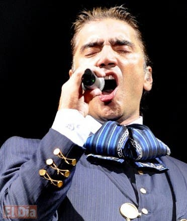 """Mexican singer Alejandro Fernandez performs at the Ricardo Saprissa Stadium in San Jose on March 07, 2008. Fernandez is on a tour to Central and South America to promote his new production """"Wind in favour"""". AFP PHOTO/ Yuri CORTEZ"""