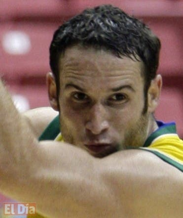 Brazil's Marcelo Huertas, left, drives to the basket as he is guarded by Canada's Jermaine Anderson during their FIBA Americas Championship quarterfinals basketball game in San Juan, Wednesday, Sept. 2, 2009. Brazil won 68-59. (AP Photo/Andres Leighton)