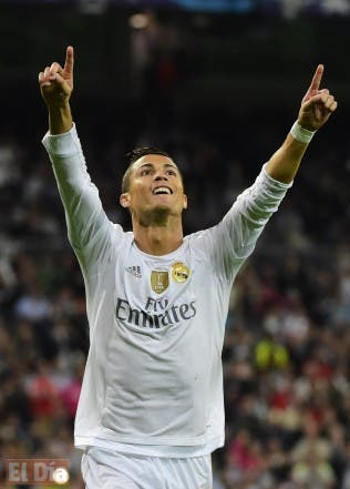 Real Madrid's Portuguese forward Cristiano Ronaldo celebrates a goal during the UEFA Champions League group A football match Real Madrid CF vs FC Shakhtar Donetsk at the Santiago Bernabeu stadium in Madrid on September 15, 2015. AFP PHOTO/ PIERRE-PHILIPPE MARCOU