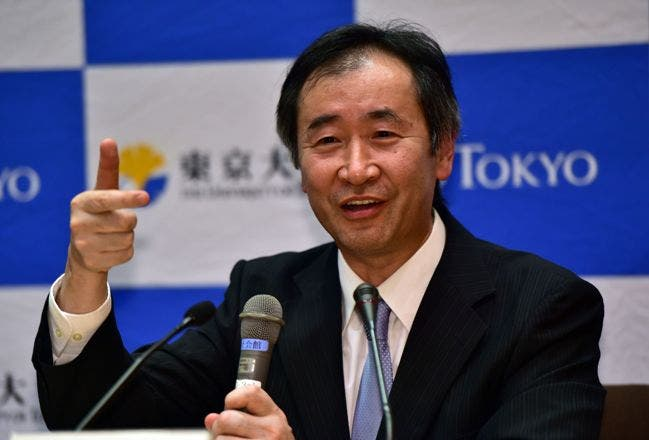 Takaaki Kajita, a professor at the University of Tokyo Institute for Cosmic Ray Research speaks at a press conference after it was announced he had won the Nobel Physics Prize at the University of Tokyo on October 6, 2015, for resolving a mystery with co-winner Arthur McDonald of Canada about neutrinos, a fundamental but enigmatic particle. The pair were honoured for work that helped determine that neutrinos have mass, the Royal Swedish Academy of Sciences said.  AFP PHOTO / Yoshikazu TSUNO