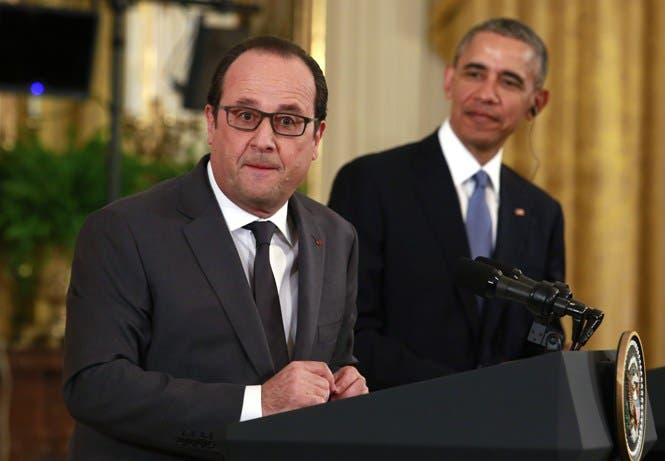 US President Barack Obama(R) and French President Francois Hollande hold a joint news conference after their meeting at the White House in Washington,DC on November 24, 2015. AFP PHOTO/YURI GRIPAS