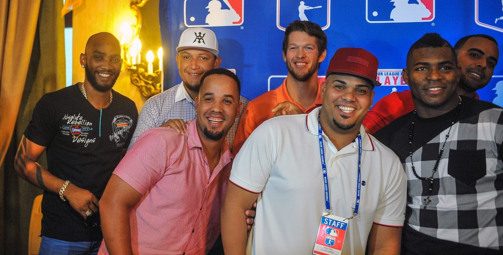 (L-R) MLB players, Cuban Alexei Ramirez, Venezuelan Miguel Cabrera, Cuban Jose Dariel Abreu, US Clayton Kershaw, Cuban Brian Pena, Cuban Yasiel Puig and Dominican Nelson Cruz pose for a picture at the National Hotel in Havana, on December 15, 2015. Cuban baseball stars Jose Abreu and Yasiel Puig are returning home Tuesday for the first time since defecting to join the American big leagues, part of an unprecedented Major League Baseball tour made possible by the thaw in US-Cuban relations. The delegation also includes Cuban-born player Alexei Ramirez, a free agent who left Cuba legally by marrying a Dominican in 2007.   AFP PHOTO/YAMIL LAGE