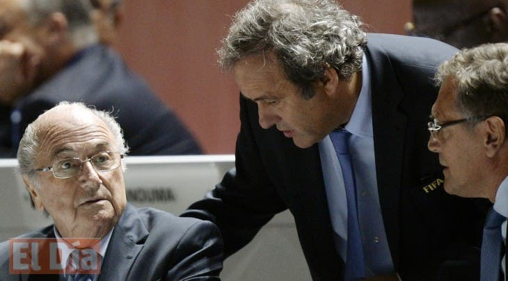FILE - In this May 29, 2015 file photo FIFA President Sepp Blatter, left, UEFA President Michel Platini, center, and FIFA Secretary General Jerome Valcke, right, are engaged in conversation during the 65th FIFA Congress held at the Hallenstadion in Zurich, Switzerland. Sepp Blatter and Michel Platini have been banned for 8 years, the FIFA ethics committee said Monday,  Dec. 21, 2015.  (Walter Bieri/Keystone via AP, file)