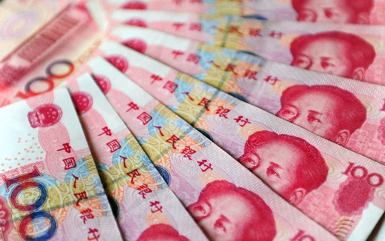 TO GO WITH Year-2010-China FOCUS by Pascale Trouillaud (FILES) A file picture taken on November 12, 2010 shows 100 yuan notes in Beijing. China solidified its financial might in 2010, becoming the world's second-largest economy, but it was often inflexible and isolated on the political stage -- an intransigence typified by the Nobel peace prize drama. Its currency policy and accusations that the yuan was undervalued dominated world summits, its first interest rate hike in nearly three years shook global markets and it earned a bigger say in the International Monetary Fund. AFP PHOTO/Frederic J. BROWN