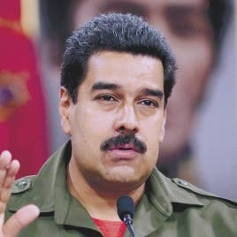 Handout picture released by the presidential press office showing Venezuelan President Nicolas Maduro as he speaks during a meeting with the Menezuelan military high command in Caracas, on June 3, 2013. AFP PHOTO/PRESIDENCIA