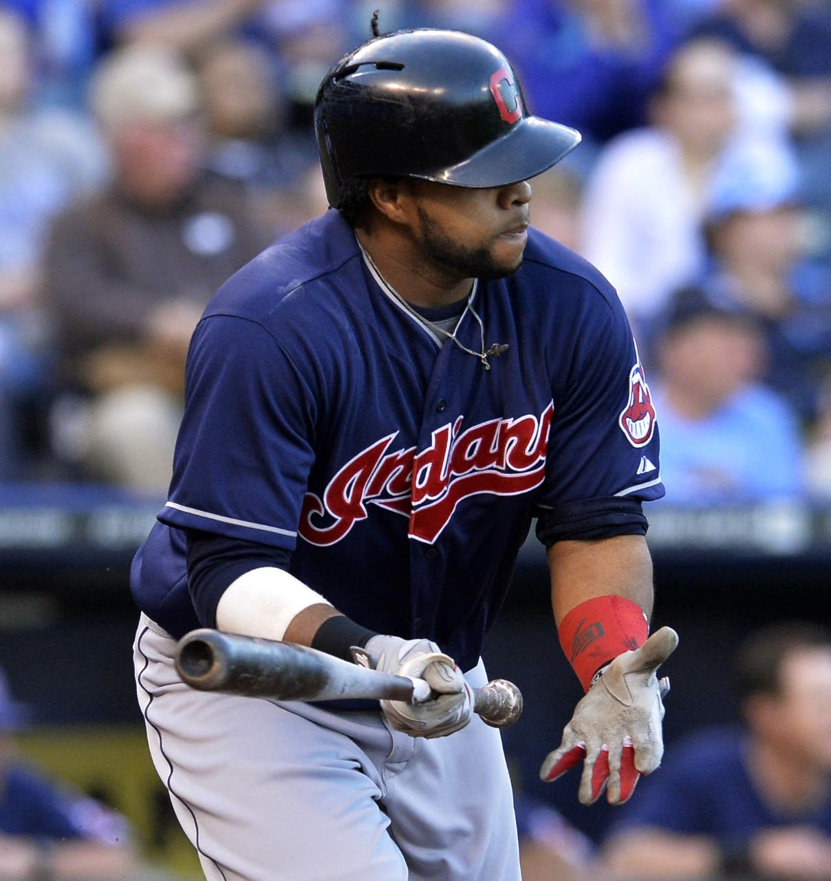 Cleveland Indians' Carlos Santana (41) sprints to first on an RBI single to give the Indians a 1-0 lead against the Kansas City Royals in the first inning of their second baseball game of a doubleheader, Sunday, April 28, 2013, in Kansas City, Mo. (AP Photo/Reed Hoffmann)