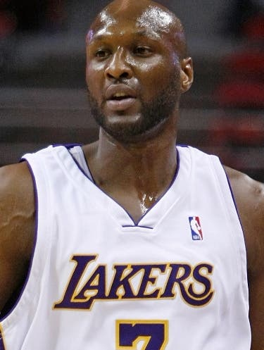 LAS VEGAS - OCTOBER 12: Lamar Odom #7 of the Los Angeles Lakers brings the ball up the court against the Sacramento Kings during their preseason game at the Thomas & Mack Center October 12, 2008 in Las Vegas, Nevada. NOTE TO USER: User expressly acknowledges and agrees that, by downloading and/or using this Photograph, user is consenting to the terms and conditions of the Getty Images License Agreement.   Ethan Miller/Getty Images/AFP == FOR NEWSPAPERS, INTERNET, TELCOS & TELEVISION USE ONLY ==