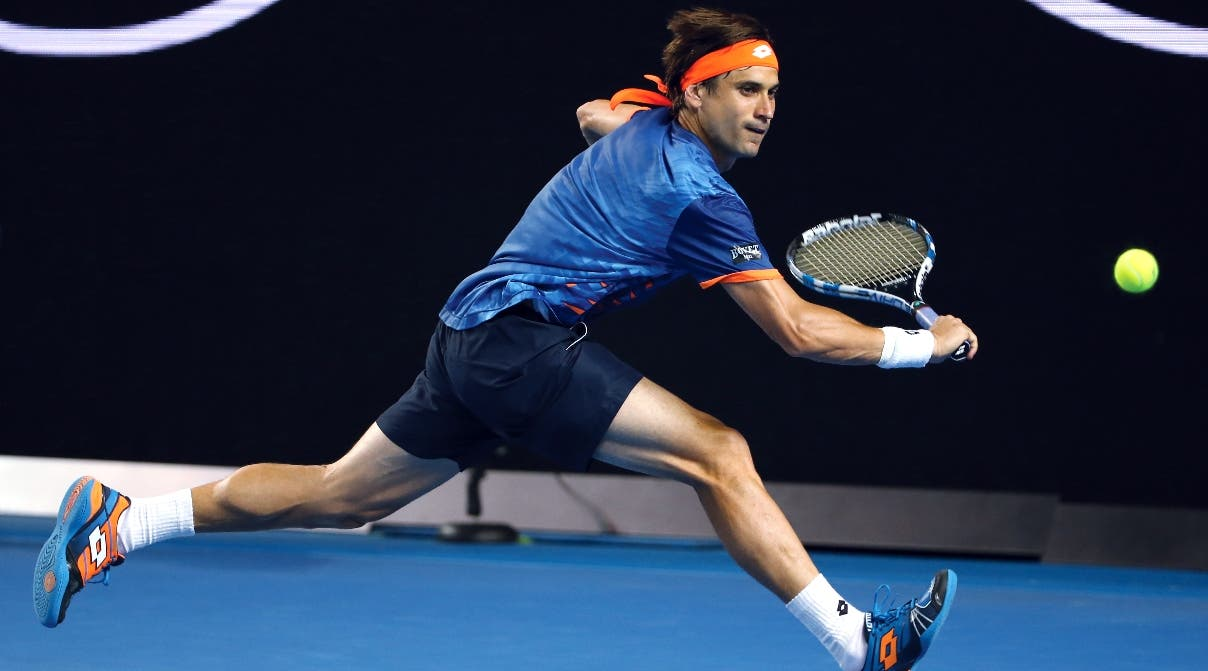 David Ferrer of Spain hits a backhand return to John Isner of the United States during their fourth round match at the Australian Open tennis championships in Melbourne, Australia, Monday, Jan. 25, 2016.(AP Photo/Rick Rycroft)