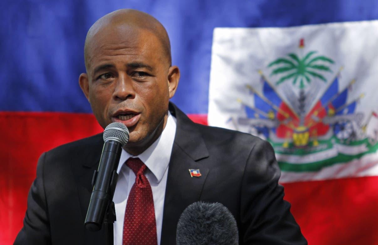 Martelly destaca acuerdo para resolver crisis y llama a deponer violencia