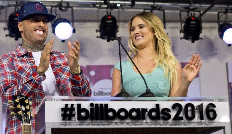 Singer songwriter Nicky Jam, left, and Venezuelan singer and actress Kimberly Dos Ramos appear during a news conference announcing the nominees for the 2016 Billboard Latin Music Awards, Wednesday, Feb. 3, 2016, in Miami. The awards show will be broadcast live on Telemundo, April 28. (AP Photo/Wilfredo Lee)