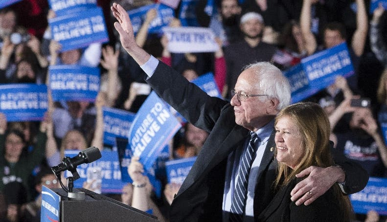Democratic presidential candidate Sen. Bernie Sanders, I-Vt., center left, waves to the crowd with his wife Jane after speaking during a primary night watch party at Concord High School, Tuesday, Feb. 9, 2016, in Concord, N.H. (AP Photo/John Minchillo)