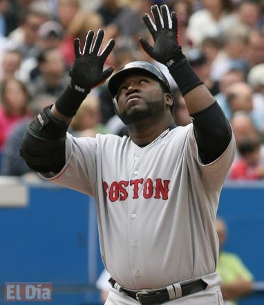Boston Red Sox's David Ortiz reacts as he runs across the plate after hitting a two-run home run against the Toronto Blue Jays during the third inning of their baseball game in Toronto, Sunday, Sept. 21, 2008.  (AP Photo/The Canadian Press,J.P. Moczulski)
