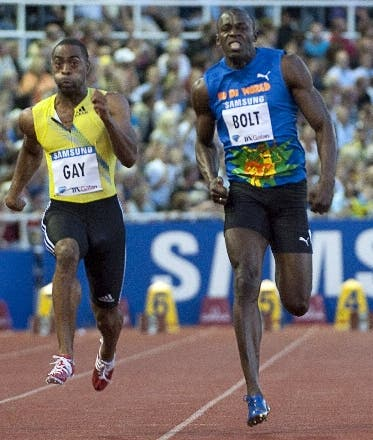 USA Tyson Gay (L) wins the men's 100 m final ahead of Jamaica's Usain Bolt (R) at the IAAF Diamond League meeting at the Stockholm Olympic Stadium in Stockholm, on August 6, 2010.   AFP Photo: Maja Suslin / SCANPIX  **  SWEDEN OUT  **