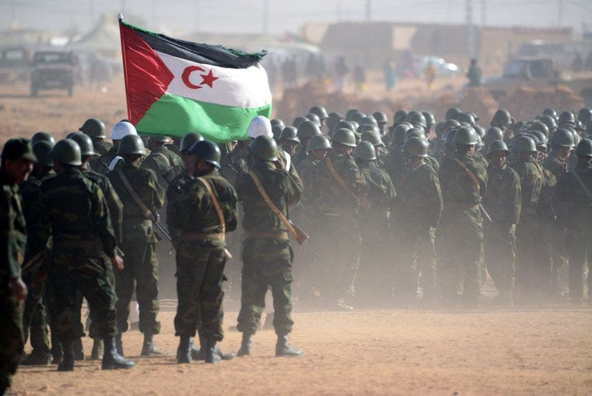 Members of the Sahrawi People's Liberation Army parade during a ceremony to mark 40 years after the Front proclaimed the Sahrawi Arab Democratic Republic (SADR) in the disputed territory of Western Sahara on February 27, 2016 at the Sahrawi refugee camp of Dakhla which lies 170 km to the southeast of the Algerian city of Tindouf.  SADR was declared in 1976 by the Polisario Front -- a rebel movement that wants independence for Western Sahara -- which fought a guerrilla war against Rabat's forces before a ceasefire in 1991.  / AFP / Farouk Batiche
