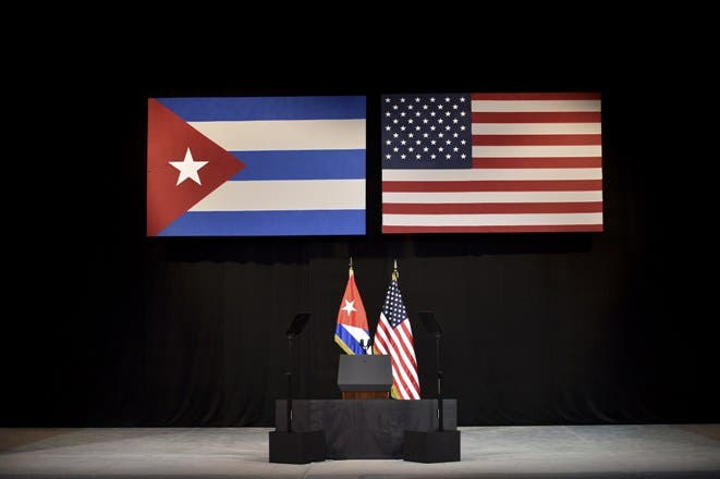 Cuban and US national flags are seen on the stage of National Theater of Havana where US President Barack Obama will be delivering remarks in Havana, Cuba on March 22, 2016. President Barack Obama was to address the Cuban people live on television Tuesday before meeting with dissidents in a challenge to the communist regime on the final day of his historic visit.  AFP PHOTO/ Yuri CORTEZ