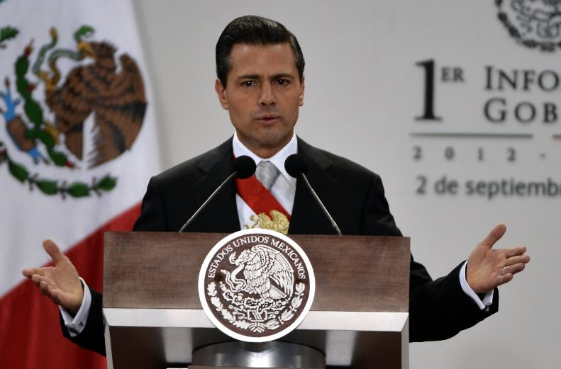 Mexican President Enrique Pena Nieto presents his first annual report to the nation, during a ceremony before the Congress, at his presidential residence of Los Pinos in Mexico City, on September 2, 2013. Pena Nieto was forced las week to change the date of his first state of the nation address due to protests by teachers angered at his education reform plan.   AFP PHOTO/OMAR TORRES