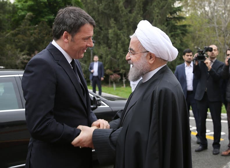 "A handout picture provided by the office of Iranian President Hassan Rouhani on April 12, 2016 shows him welcoming Italian Prime Minister Matteo Renzi (L) during a ceremony at the presidential palace in Tehran.   == RESTRICTED TO EDITORIAL USE - MANDATORY CREDIT ""AFP PHOTO / HO / IRANIAN PRESIDENCY"" - NO MARKETING NO ADVERTISING CAMPAIGNS - DISTRIBUTED AS A SERVICE TO CLIENTS ==  / AFP / IRANIAN PRESIDENCY / STRINGER / == RESTRICTED TO EDITORIAL USE - MANDATORY CREDIT ""AFP PHOTO / HO / IRANIAN PRESIDENCY"" - NO MARKETING NO ADVERTISING CAMPAIGNS - DISTRIBUTED AS A SERVICE TO CLIENTS =="