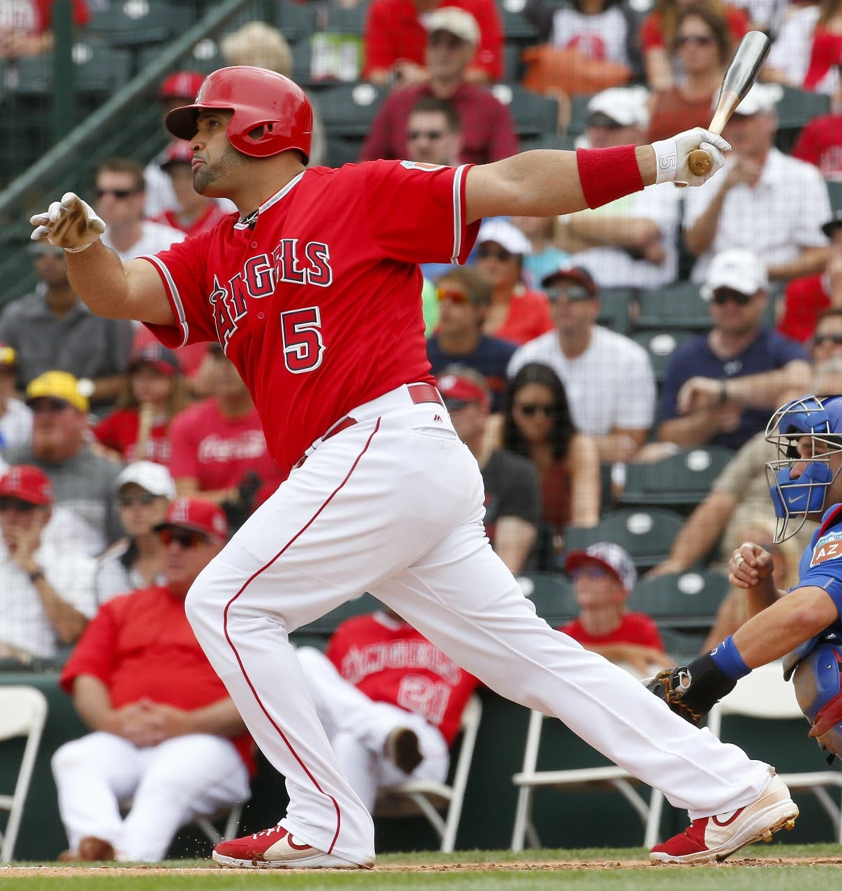 Los Angeles Angels' Albert Pujols follows through on an RBI double against the Chicago Cubs during the first inning of a spring training baseball game, Monday, March 28, 2016, in Tempe, Ariz. (AP Photo/Matt York)