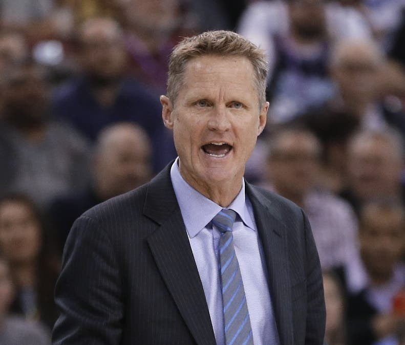 Golden State Warriors coach Steve Kerr  calls out instructions to his team during the fourth quarter of an NBA basketball game against the Sacramento Kings in Sacramento, Calif., Tuesday, Feb. 3, 2015. The Warriors won 121-96. (AP Photo/Rich Pedroncelli)