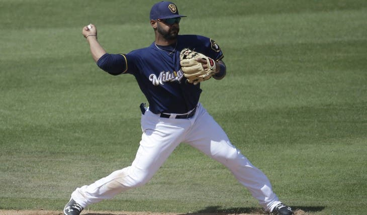 Milwaukee Brewers' Jonathan Villar makes a play on a ball hit by Cincinnati Reds' Adam Duvall during the fifth inning of a spring training baseball game Tuesday, March 29, 2016, in Phoenix. Jay Bruce was forced out at second on the play. (AP Photo/Darron Cummings)