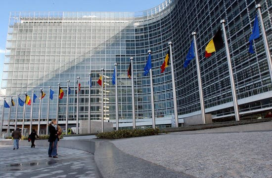 Belgian tricolor and European Union flags are seen on at the side entrance of the renovated Berlaymont Commission building in Brussels, Thursday Oct.21, 2004. EU Commission President Romano Prodi inaugurated the renovated Berlaymont building which will become the home of the European Union's head office after years of scandal and chaos surrounding the restoration. (AP Photo/Yves Logghe)