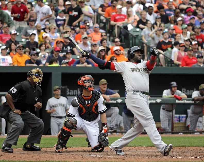 Boston Red Sox designated hitter David Ortiz, right, watches his solo home run in front of Baltimore Orioles catcher Caleb Joseph and home plate umpire Laz Diaz in the eighth inning of a baseball game in Baltimore, Monday, May 30, 2016. Boston won 7-2. (AP Photo/Patrick Semansky)