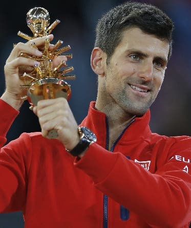 Novak Djokovic, from Serbia, lifts up his trophy after winning a Madrid Open tennis tournament final match against Andy Murray, from Britain in Madrid, Spain, Sunday, May 8, 2016. (AP Photo/Francisco Seco)