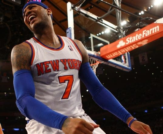 NEW YORK, NY - FEBRUARY 10: Carmelo Anthony #7 of the New York Knicks reacts to a call against the Los Angeles Clippers during their game at Madison Square Garden on February 10, 2013 in New York City. NOTE TO USER: User expressly acknowledges and agrees that, by downloading and or using this photograph, User is consenting to the terms and conditions of the Getty Images License Agreement.   Al Bello/Getty Images/AFP== FOR NEWSPAPERS, INTERNET, TELCOS & TELEVISION USE ONLY ==