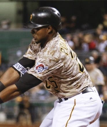 Pittsburgh Pirates' Gregory Polanco, left, strikes out as the pitch gets by Atlanta Braves catcher Tyler Flowers, right, for a pass ball with the bases loaded, allowing Chris Stewart to score from third in the sixth inning of a baseball game, Thursday, May 19, 2016, in Pittsburgh. Polanco was throw out at first. (AP Photo/Keith Srakocic)