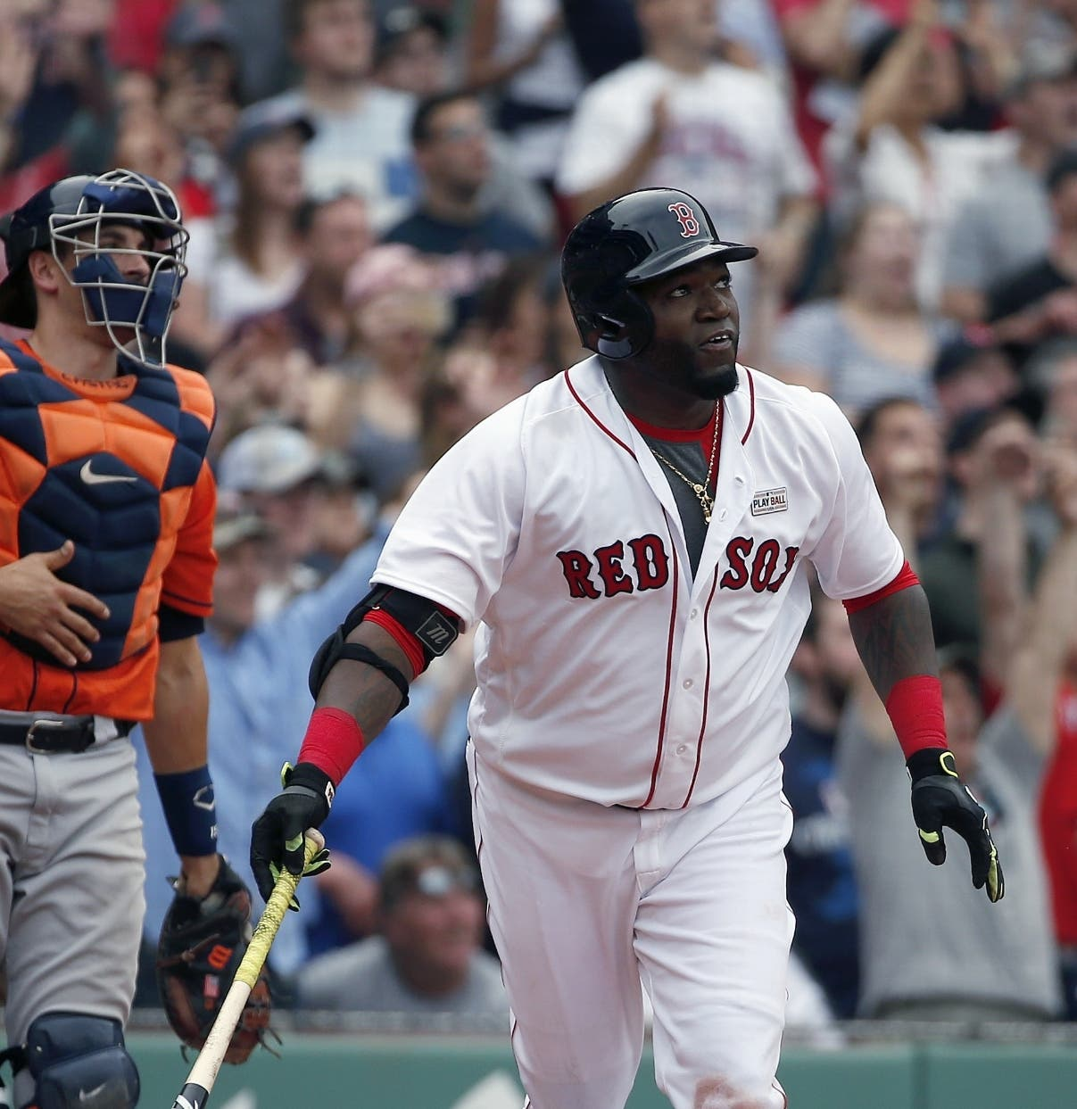 Boston Red Sox's David Ortiz, right, watches his game-winning double in front of Houston Astros' Jason Castro during the 11th inning of a baseball game in Boston, Saturday, May 14, 2016. The Red Sox won 6-5. (AP Photo/Michael Dwyer)