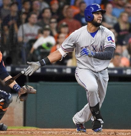 Texas Rangers' Nomar Mazara watches his two-run home run during the seventh inning of a baseball game against the Houston Astros, Sunday, May 22, 2016, in Houston. (AP Photo/Eric Christian Smith)