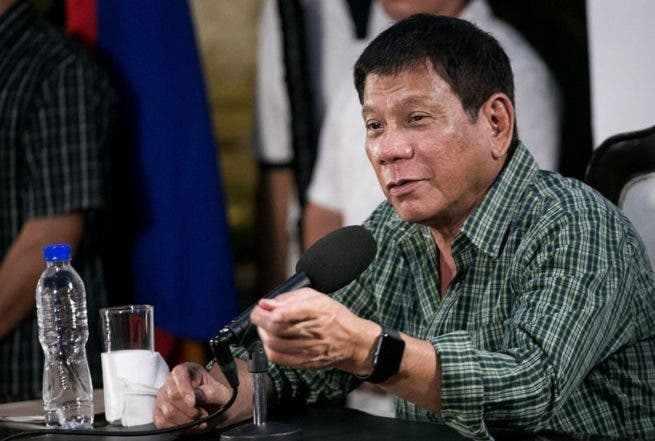 Philippines' president-elect Rodrigo Duterte speaks during a press conference in Davao on May 31, 2016. Philippine president-elect Rodrigo Duterte's war on crime appears to have begun ahead of him taking office, rights activists said May 31 as they voiced concern over a spate of police and vigilante killings. / AFP / MANMAN DEJETO