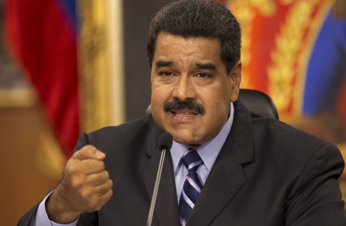Venezuela's President Nicolas Maduro speaks during a press conference at the Miraflores presidential palace in Caracas, Venezuela, Tuesday, May 17, 2016. Maduro accused the United States of sabotage plans against Venezuela, saying they aim to create a scenario of violence to justify a foreign military intervention to remove him from power. (AP Photo/Ariana Cubillos)