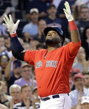 Boston Red Sox's David Ortiz celebrates his two-run home run while crossing the plate in front of Seattle Mariners catcher Chris Iannetta during the fourth inning of a baseball game at Fenway Park on Friday, June 17, 2016, in Boston. (AP Photo/Elise Amendola)