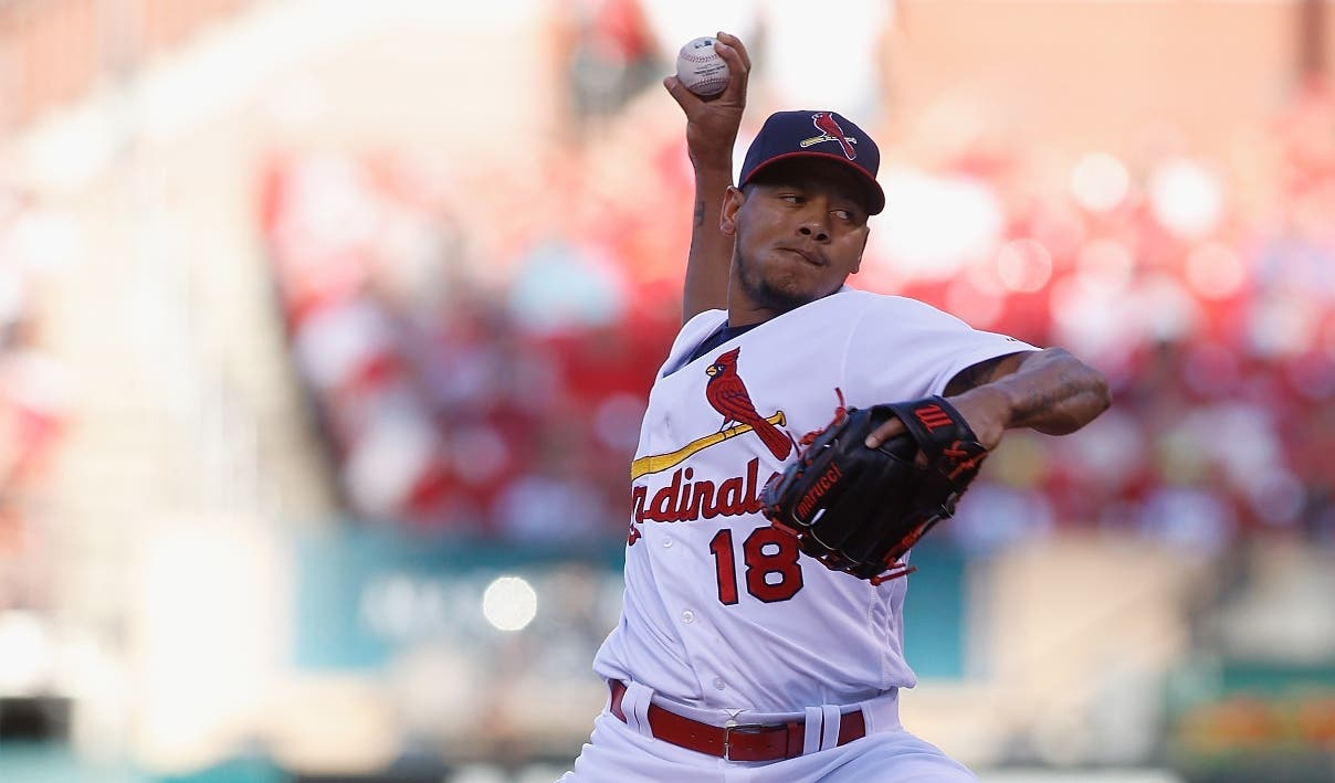 St. Louis Cardinals starting pitcher Carlos Martinez pitches against the San Francisco Giants during the first inning of a baseball game, Sunday, June 5, 2016 in St. Louis. (AP Photo/Scott Kane)