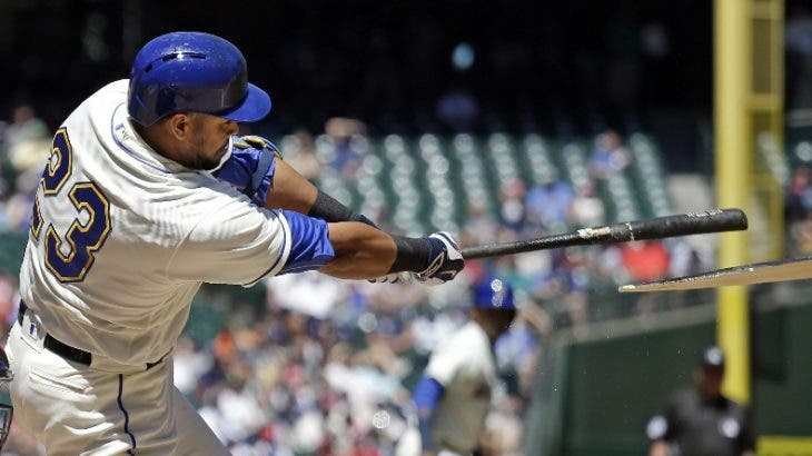 Seattle Mariners' Nelson Cruz breaks his bat as he drives in a run on a fielder's choice against the St. Louis Cardinals in the first inning of a baseball game Sunday, June 26, 2016, in Seattle. (AP Photo/Elaine Thompson)