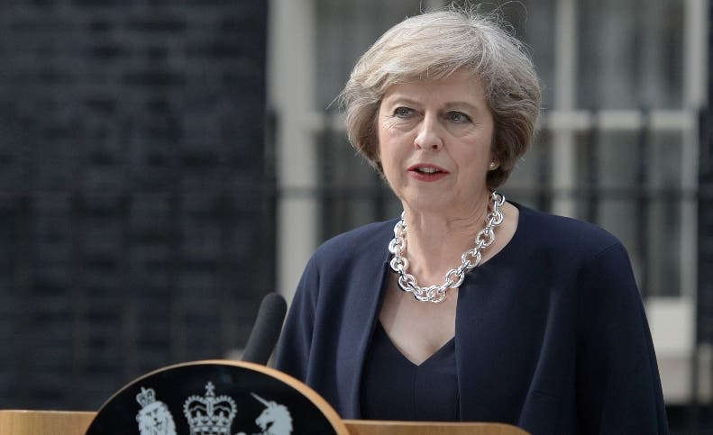Britain's new Prime Minister Theresa May speaks outside 10 Downing Street in central London on July 13, 2016 on the day she takes office following the formal resignation of David Cameron.  Theresa May took office as Britain's second female prime minister on July 13 charged with guiding the UK out of the European Union after a deeply devisive referendum campaign ended with Britain voting to leave and David Cameron resigning.   / AFP / OLI SCARFF